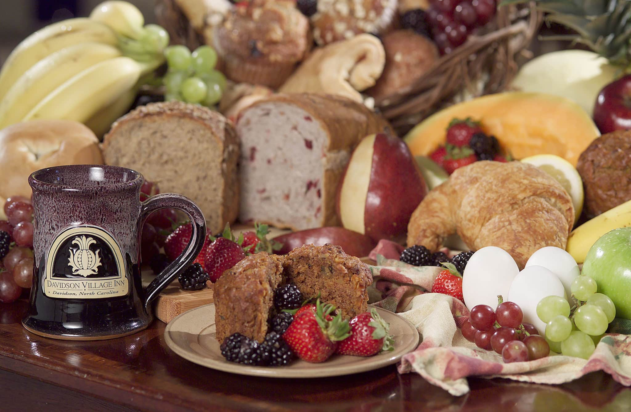 Delicious display of continental breakfast foods like fresh baked bread and fresh fruit