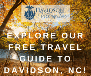 "Image of fall foliage with the text ""Explore our free Travel Guide to Davidson, NC!"""