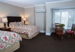 Two beds in the family suite guest room at Davidson Village Inn