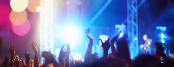 Hands in the air at a concert.