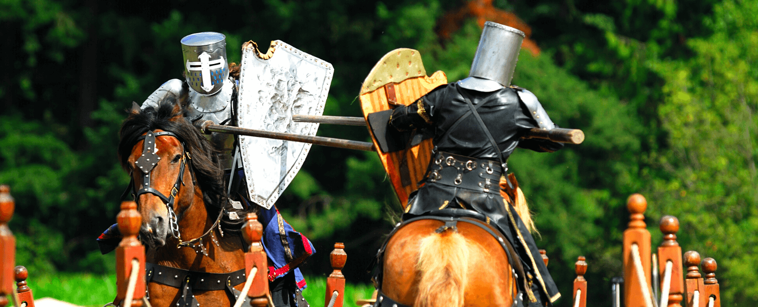 Two knights jousting on horseback