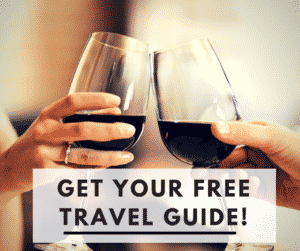 "People with wine glasses and the text, ""Get Your Free Travel Guide!"""